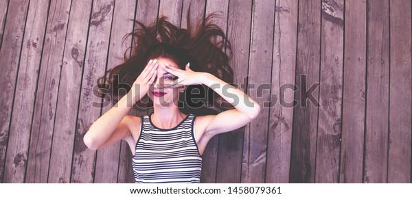 Beautiful Young Girl Peeking Through Fingers Stock Photo Edit Now