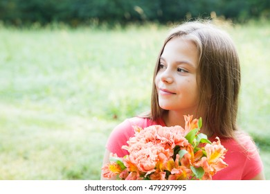 Beautiful young girl portrait with flowers over blurred background