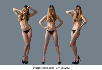 Beautiful young girl posing in a black swimsuit. Studio. Isolated on gray.