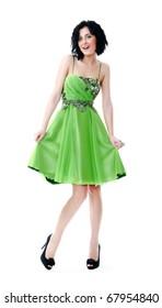 Beautiful young girl posing in a green dress