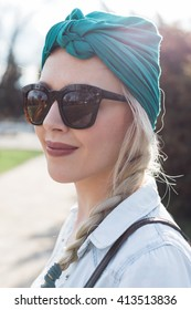 Beautiful young girl posing with turban, spring time
