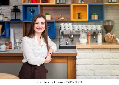 beautiful young girl preparing coffee in a cafe barista