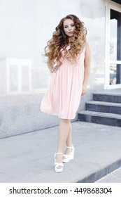 Beautiful young girl at the prom with gorgeous long curly hair . Professional make-up and hairstyle , stylish woman .
