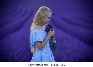 beautiful young girl in provence lavender field background in valensole