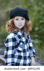 Beautiful young girl with red hair outdoors in Autumn season with sad expression