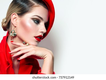 Beautiful young girl in a red jacket and a red beret.fashion, beauty, clothing, hats, makeup, accessories, make-up artist, boutique, beauty salon.