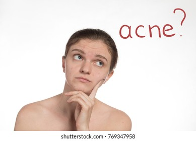 Beautiful young girl with red and white acne on her face. Stop acne on a white background.