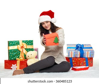 beautiful young girl in santa hat with gift boxes, white background