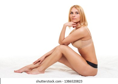 Beautiful young girl in sexy body underwear posing in white studio