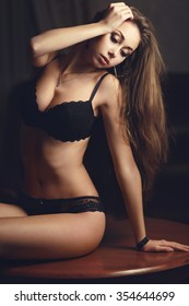 beautiful young girl in a sexy lingerie on a table