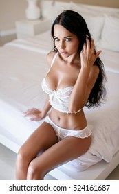 Beautiful young girl in a sexy white lingerie