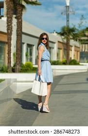 Beautiful young girl shopping in the big city