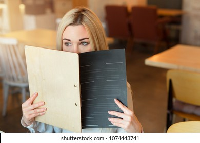 Image result for pics of people looking at menus