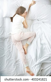 Beautiful young girl sleeping in the bedroom.
