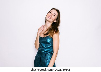 Beautiful young girl smile in blue t-shirt and riding breeches on a white background