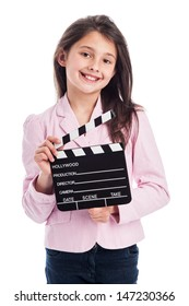 Beautiful young girl, smiling to camera while holding a movie makers clapperboard. Isolated on studio white background.