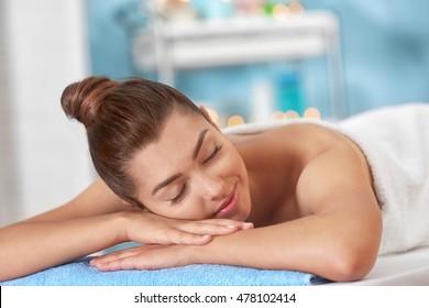 Beautiful young girl in spa salon