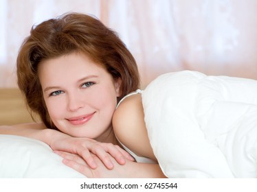 beautiful young girl spending the morning in bed