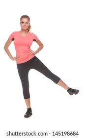 Beautiful young girl in sport clothes doing sport exercise over white background