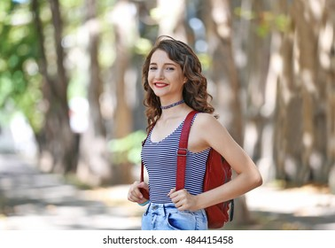 Beautiful young girl standing on street
