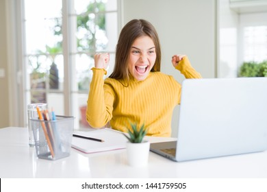 Beautiful young girl studying for school using computer laptop screaming proud and celebrating victory and success very excited, cheering emotion