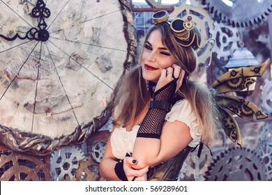 beautiful young girl in the style of steampunk with mechanical wings and goggle