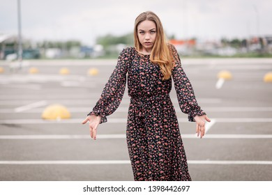 Beautiful young girl surprised in parking