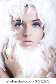 Beautiful young girl with swan feathers