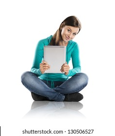 Beautiful young girl with tablet in studio