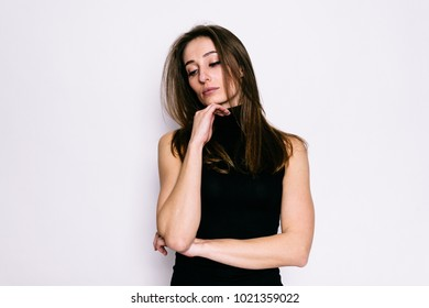 Beautiful young girl thought about in black golf on a white background
