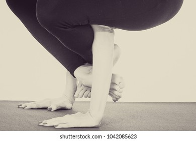 Beautiful young girl in top and pants for yoga near white wall