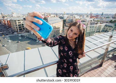 Beautiful young girl tourist shoots selfie in Moscow, Russia
