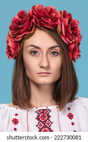 Beautiful young girl in the Ukrainian national suit isolated