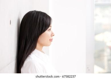 beautiful young girl waiting, in profile