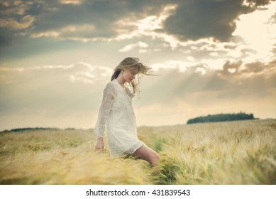 beautiful young girl walking in a field
