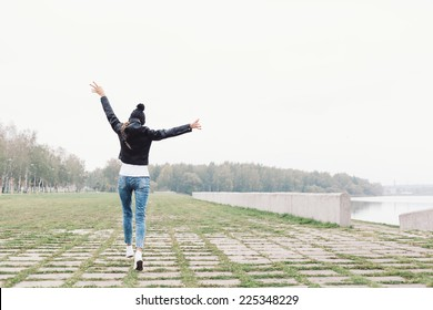 Beautiful young girl walking and having fun. Outdoor lifestyle portrait of woman