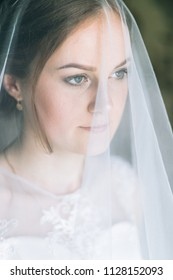 Beautiful young girl is in a wedding decoration