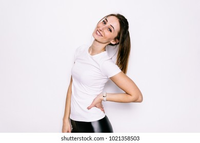 Beautiful young girl in a white t-shirt on a white background