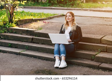 Beautiful Young Girl Working on Laptop Outside Her Office, Freelance Concept