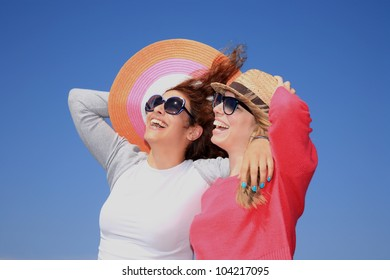 beautiful young girls with hats and having fan outdoor