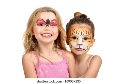 Beautiful young girls with painted faces, tiger and ladybug