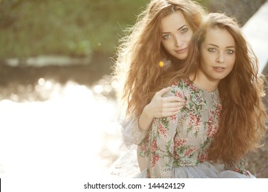 Beautiful young happy twins outdoors