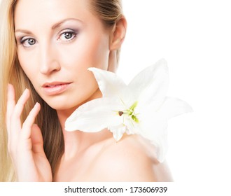 Beautiful, young and healthy girl with a fresh lily flower
