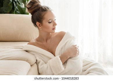 Beautiful young healthy woman relaxing in a robe, picture of beautiful woman beautiful woman in spa salon