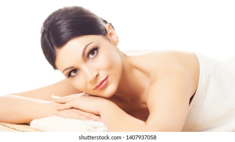 Beautiful, young and healthy woman in spa. Massage, health and healing concept.