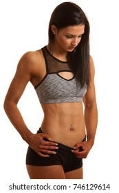 Beautiful young hispanic fit sporty woman studio portrait