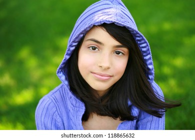 beautiful young hispanic preteen girl in hoodie