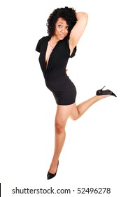 A beautiful young Hispanic woman, in a black short and tight dress and high heels is dancing in the studio, for white background.