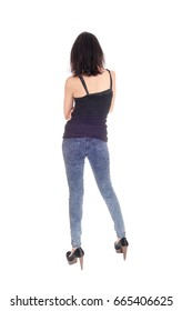 A beautiful young Hispanic woman in a black t-shirt and blue tights standing from the back, isolated for white background.