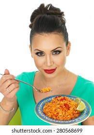 Beautiful Young Hispanic Woman Holding A Plate of Spicy Mexican Fried Rice With Fresh Lime Against A White Background